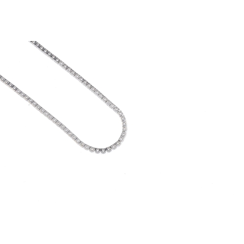 324 - A diamond line necklace. Comprising a series of brilliant-cut diamonds, to the partially concealed c...