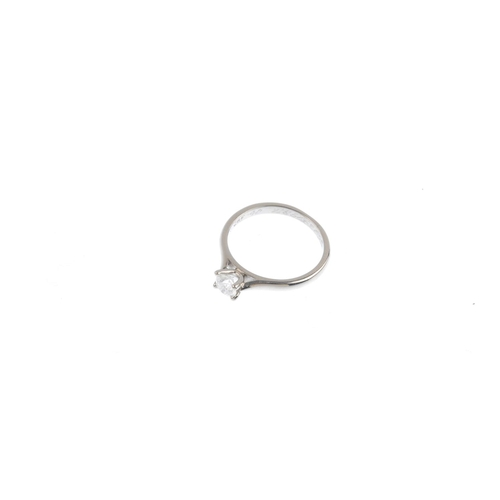 325 - A platinum diamond single-stone ring. The brilliant-cut diamond, with tapered shoulders. Diamond gir...