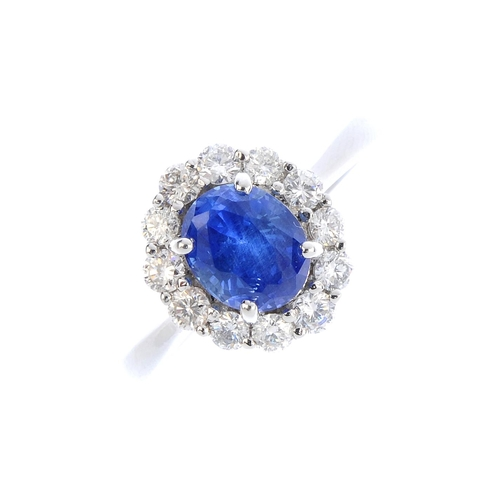 326 - A Sri Lankan sapphire and diamond cluster ring. The oval-shape sapphire, weighing 2.05cts, with bril...