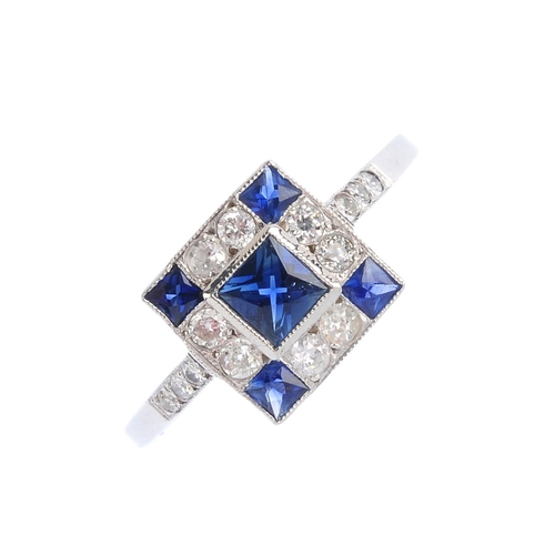 327 - A sapphire and diamond dress ring.  The square-shape sapphire, with similarly-shaped sapphire and va...