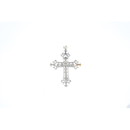 330 - A diamond and enamel cross pendant. Of openwork design, the brilliant-cut diamond cross, with black ...