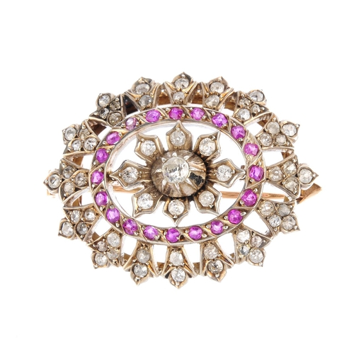 340 - A late 19th century silver and gold, ruby and diamond brooch. Of oval outline, the vari-cut diamond ...