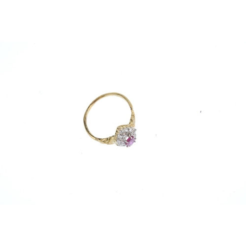 345 - A ruby and diamond cluster ring. The oval-shape ruby, with old-cut diamond marquise-shape panel surr...
