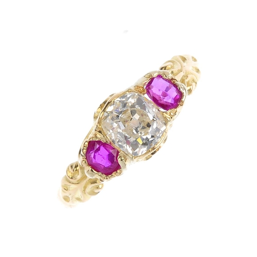 349 - An early 20th century gold, diamond and ruby three-stone ring. The old-cut diamond, with oval-shape ...