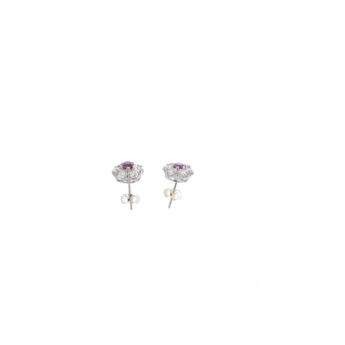 351 - A pair of ruby and diamond earrings. Each designed as a circular-shape ruby, with old-cut diamond su...