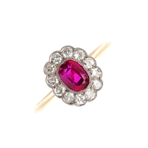 353 - A Burmese ruby and diamond cluster ring. The oval-shape ruby, weighing 0.84ct, with brilliant-cut di...
