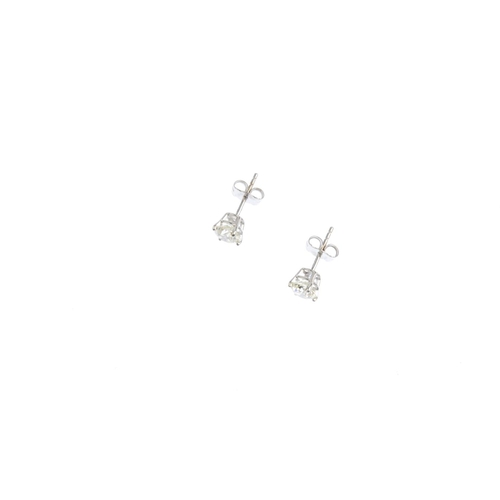 354 - A pair of 18ct gold brilliant-cut diamond stud earrings. Total diamond weight 1.82cts, estimated L-t...