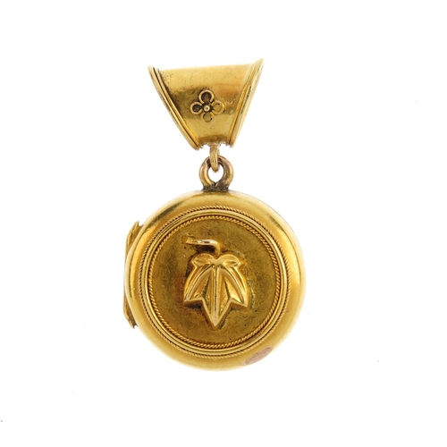 360 - A late Victorian 18ct gold locket. Of circular outline, with raised letters PAX and ivy leaf reverse...