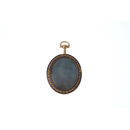 366 - A late Georgian gold portrait miniature locket. Of oval outline, depicting a gentleman in three-quar...