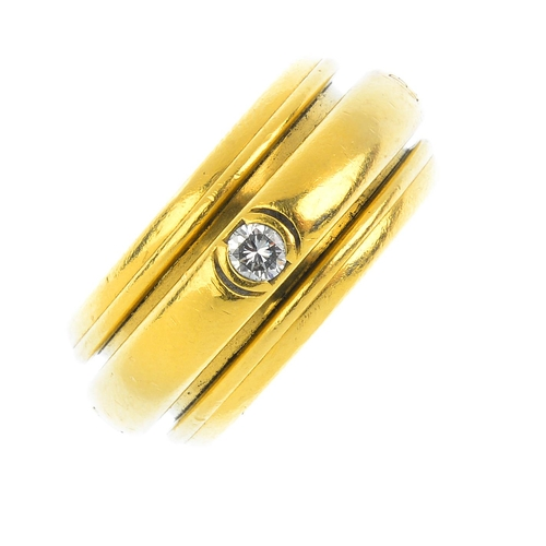368 - PIAGET - a diamond 'Possession' ring. Designed as a brilliant-cut diamond accent rotating band, with...