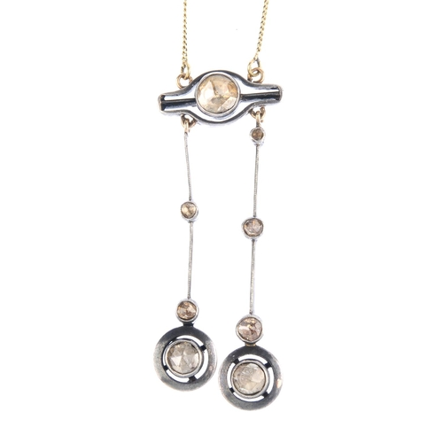 37 - A diamond negligee necklace. The rose-cut diamond asymmetric drops, with halo terminals, suspended f...