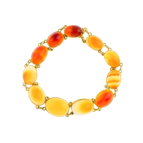 370 - An agate bracelet. Designed as a graduated oval agate cabochon line, with push-piece clasp. Length 1...