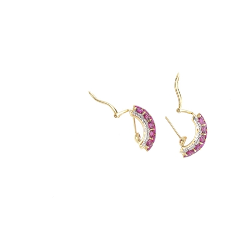 371 - A pair of ruby and diamond earrings. Each designed an oval-shape ruby arch, with circular-cut diamon...