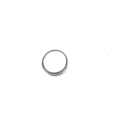 38 - A platinum diamond half eternity ring. The graduated brilliant-cut diamond line, with similarly-cut ...