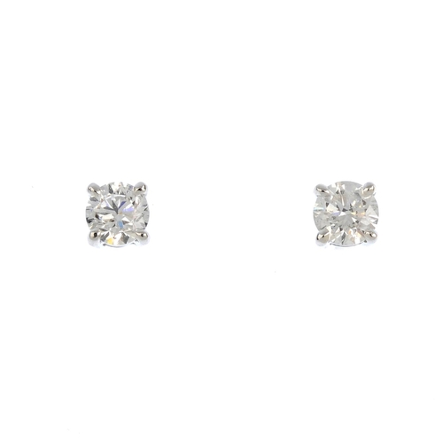 380 - A pair of brilliant-cut diamond stud earrings. Total diamond weight 1.02cts, estimated H-I colour, P...