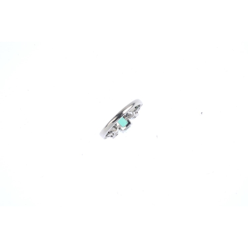 384 - A mid 20th century 18ct gold Colombian emerald and diamond three-stone ring. The rectangular-shape e...