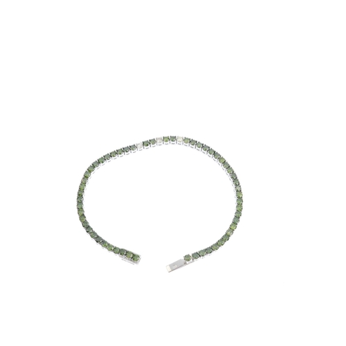 387 - A colour treated diamond bracelet. Designed as a brilliant-cut colour treated 'green' diamond line, ...
