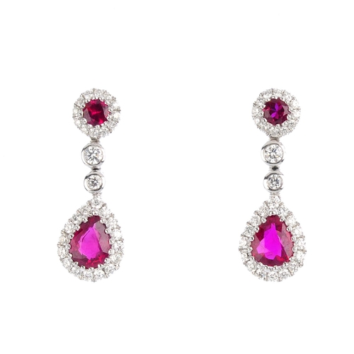 39 - A pair of ruby and diamond earrings. Each designed as a pear-shape ruby and brilliant-cut diamond cl...
