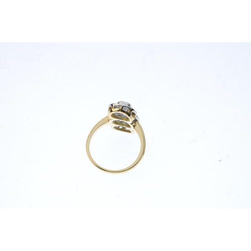 390 - An 18ct gold diamond dress ring. The brilliant-cut diamond collet line, with similarly-cut diamond s...