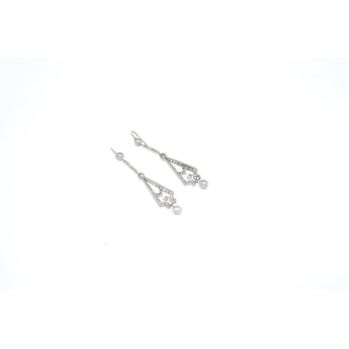 391 - A pair of diamond earrings. Each designed as a single-cut diamond geometric panel and bar, with bril...