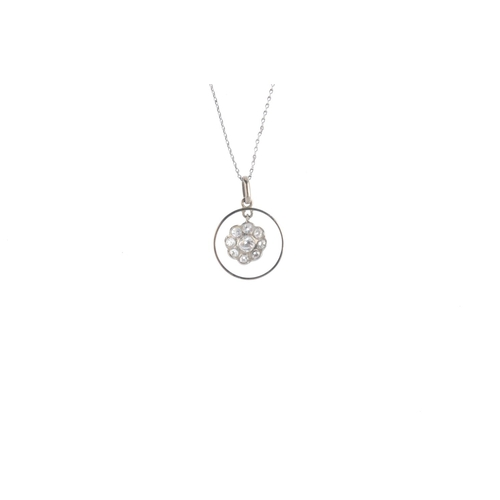 392 - A diamond pendant. The brilliant and circular-cut diamond cluster, suspended within a halo, to the p...