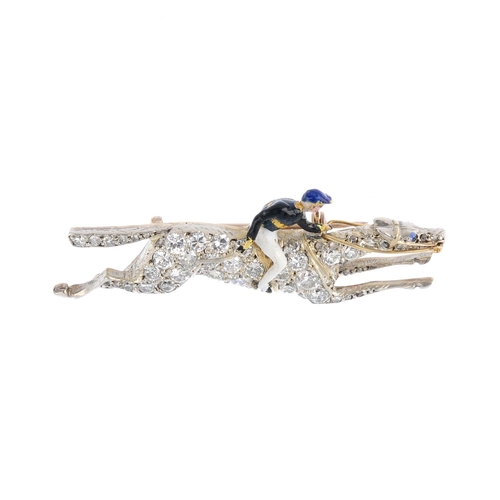394 - A diamond and enamel horse and jockey brooch. The pave-set diamond racehorse with blue-gem eye, in m...