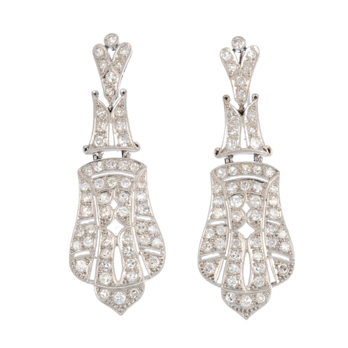 395 - A pair of diamond earrings. Each of geometric design, comprising a series of single-cut diamond pier...