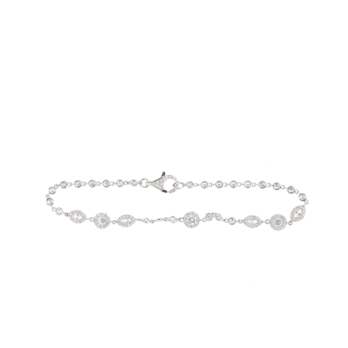 40 - A diamond bracelet. The brilliant-cut diamond cluster, with similarly-set brilliant-cut and marquise...
