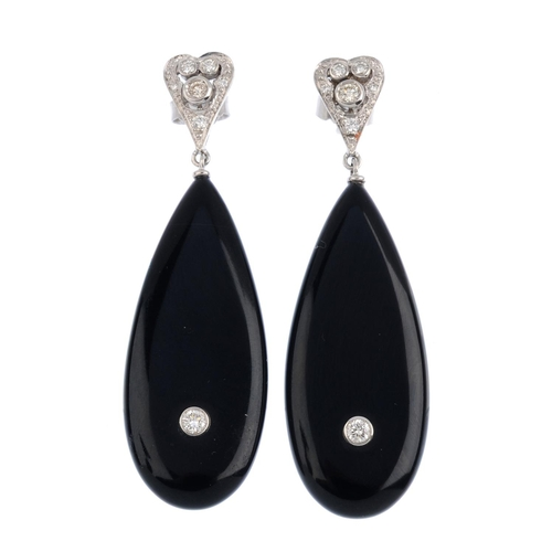 400 - A pair of diamond and onyx earrings. Each designed as an onyx tapered drop with brilliant-cut diamon...
