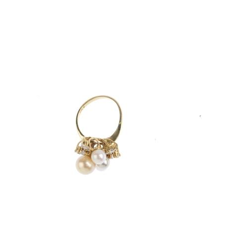 402 - A cultured pearl and diamond dress ring. Designed as a vari-size and colour cultured pearl and brill...