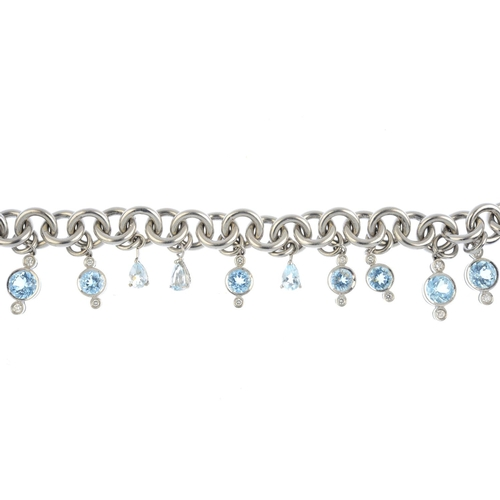 404 - An 18ct gold aquamarine and diamond bracelet. The belcher-link chain, suspending a vari-size and sha...