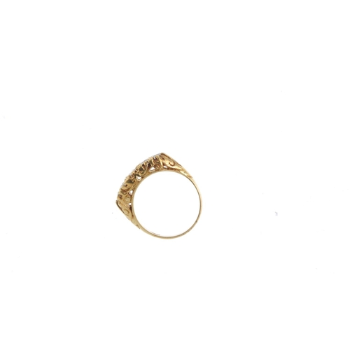 407 - A diamond five-stone ring. The graduated brilliant-cut diamond line, with scrolling gallery and foli...
