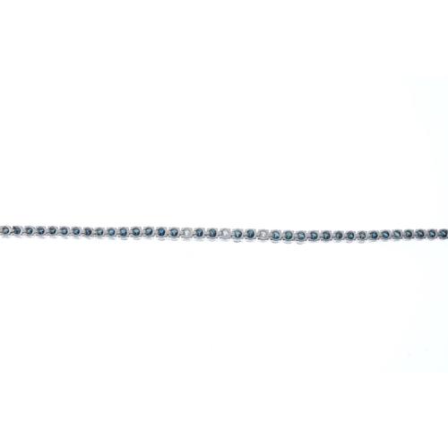 410 - A colour treated diamond bracelet. Designed as a brilliant-cut colour treated blue diamond line, wit...