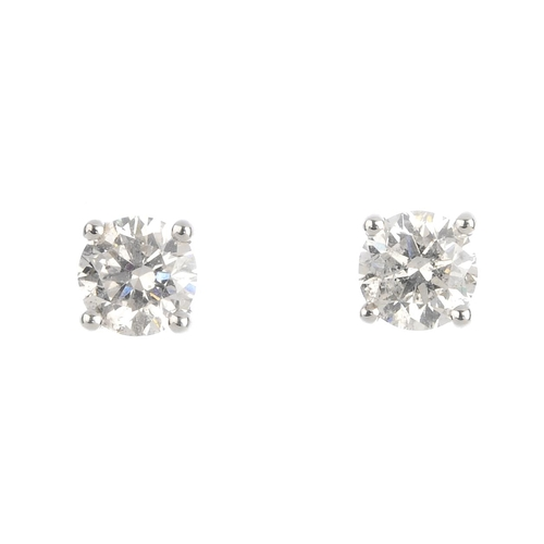 412 - A pair of brilliant-cut diamond stud earrings. Total diamond weight 1.25cts, estimated G-H colour, P...