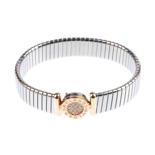 416 - BULGARI - a steel and 18ct gold diamond 'Tubogas' bracelet. Of bi-colour design, the brilliant-cut d...