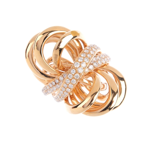 419 - A diamond dress ring. Designed as a stylised knot, with pave-set diamond crossover line highlights. ...