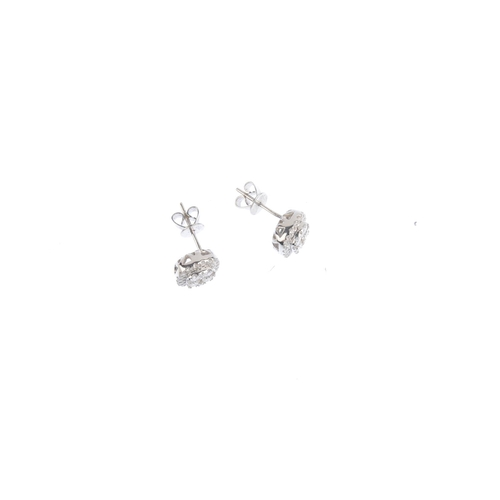 42 - A pair of 18ct gold diamond cluster earrings. Each designed as a brilliant-cut diamond square-shape ...