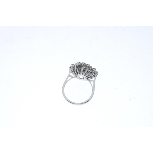 420 - A diamond cluster ring. The brilliant-cut diamond with similarly-cut diamond quatrefoil surround and...