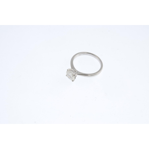 422 - An 18ct gold diamond single-stone ring. The brilliant-cut diamond with tapered shoulders. Diamond we...