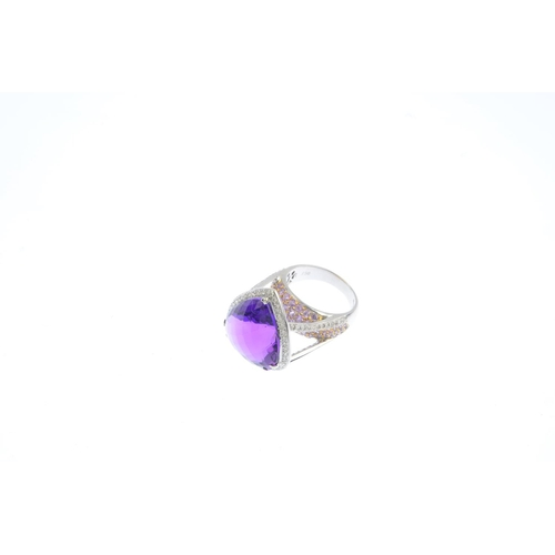 423 - An 18ct gold amethyst, sapphire and diamond dress ring. The pear-shape amethyst, with brilliant-cut ...