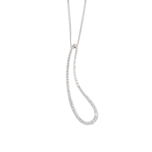 424 - An 18ct gold diamond pendant. The graduated brilliant-cut diamond tapered loop, suspended from a cur...
