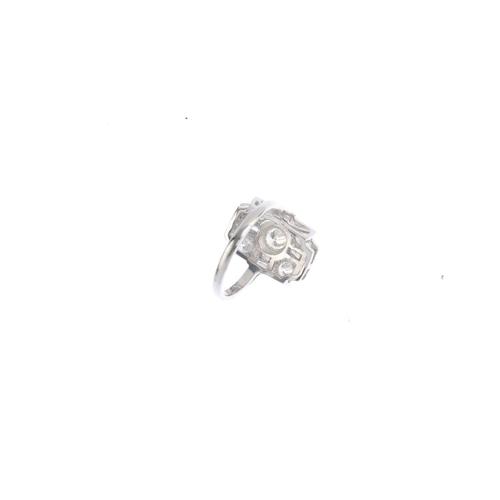 425 - A diamond dress ring. The brilliant-cut diamond collet, within a vari-cut diamond geometric surround...