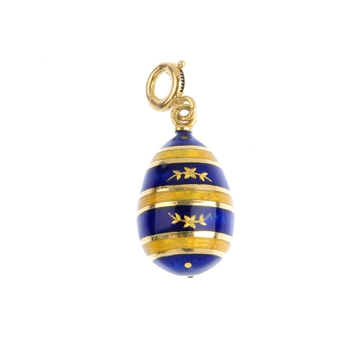 433 - FABERGE - an enamel egg pendant. Designed as a series of blue and yellow guilloche enamel stripes, w...