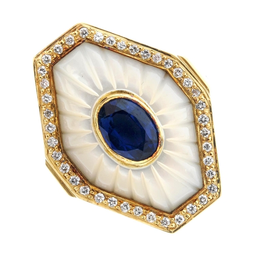 437 - GARRARD - an 18ct gold diamond and gem-set ring. The oval-shape sapphire collet, with grooved mother...