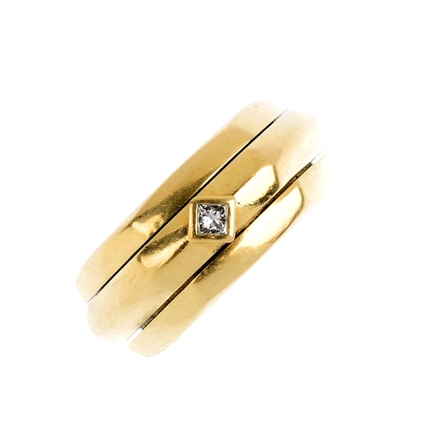 438 - PIAGET - a diamond 'Possession' ring. Of hexagonal outline, the rotating angular band, with square-s...