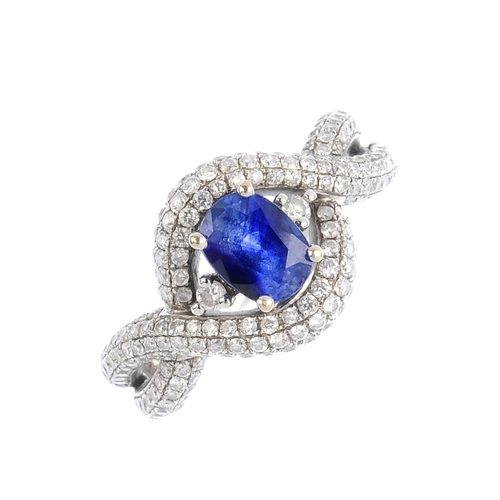441 - An 18ct gold sapphire and diamond dress ring. The oval-shape sapphire, with brilliant-cut diamond cr...