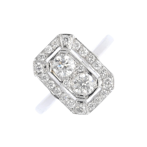 442 - A diamond dress ring. Of rectangular openwork design, the brilliant-cut diamond line, with similarly...