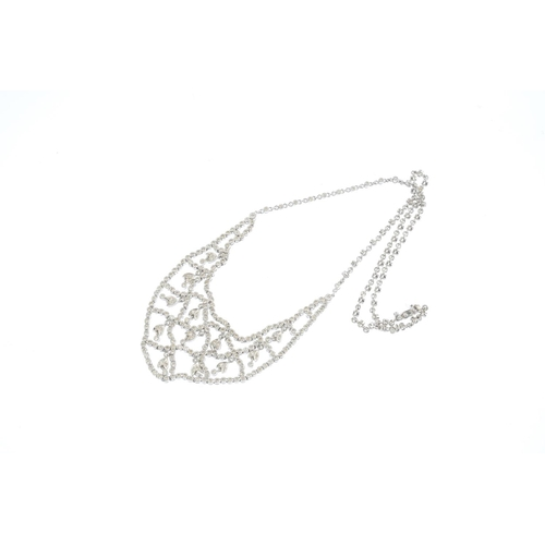 444 - A diamond necklace. Designed as a series of brilliant-cut diamond floral drops, suspended within a s...