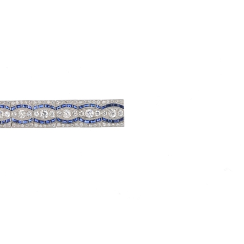 446 - A diamond and sapphire bracelet. Designed as a series of graduated old-cut diamond brilliant-cut dia...