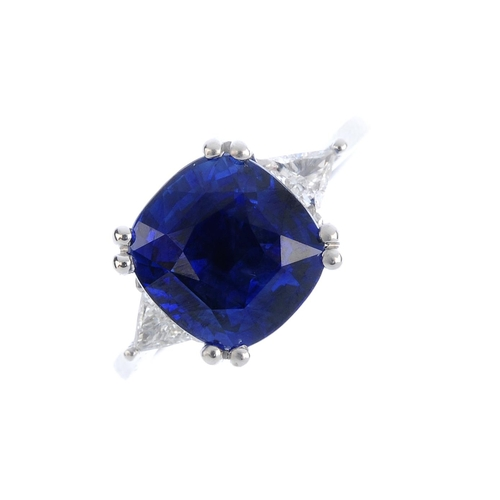 447 - An 18ct gold sapphire and diamond single-stone ring. The cushion-shape sapphire, with triangular-sha...